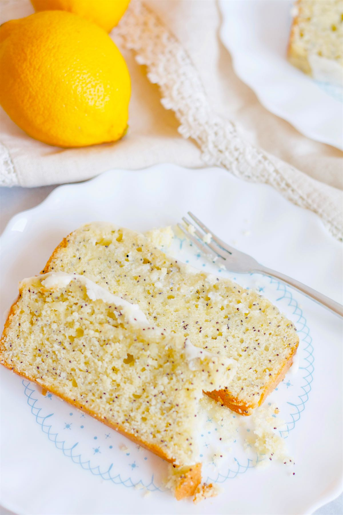 Slices of Lemon Poppy Seed Loaf on a plate