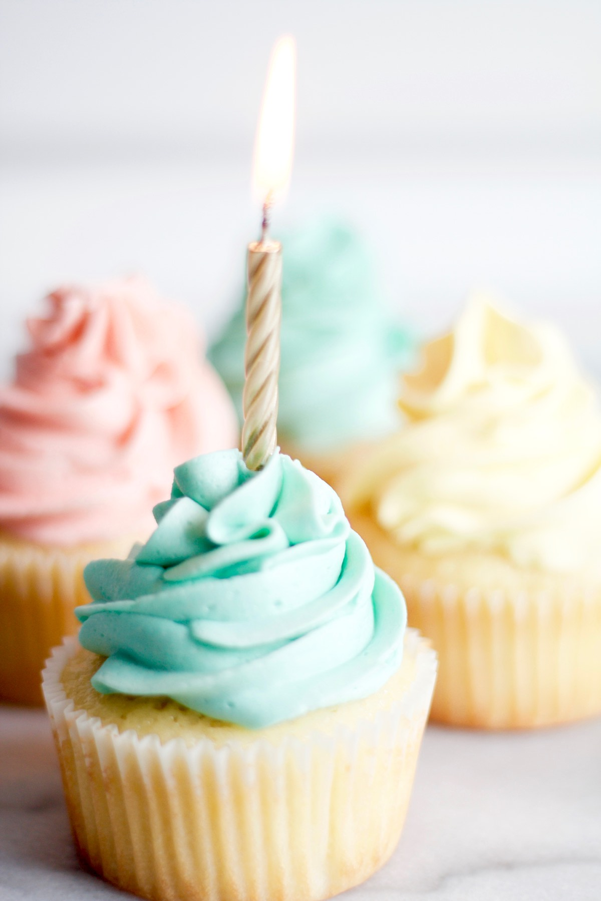 Vanilla Birthday Cupcakes with a lighted candel