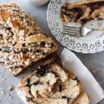 The contrast between the layers of bread and the sticky, delicious swirls of black cocoa, chocolate chips, and cashew nuts make this babka irresistible – It's difficult to stop at one slice! And while it's perfect alongside coffee or tea, it is by no means limited to morning consumption and can be all-too-easily eaten as an afternoon snack or dessert.