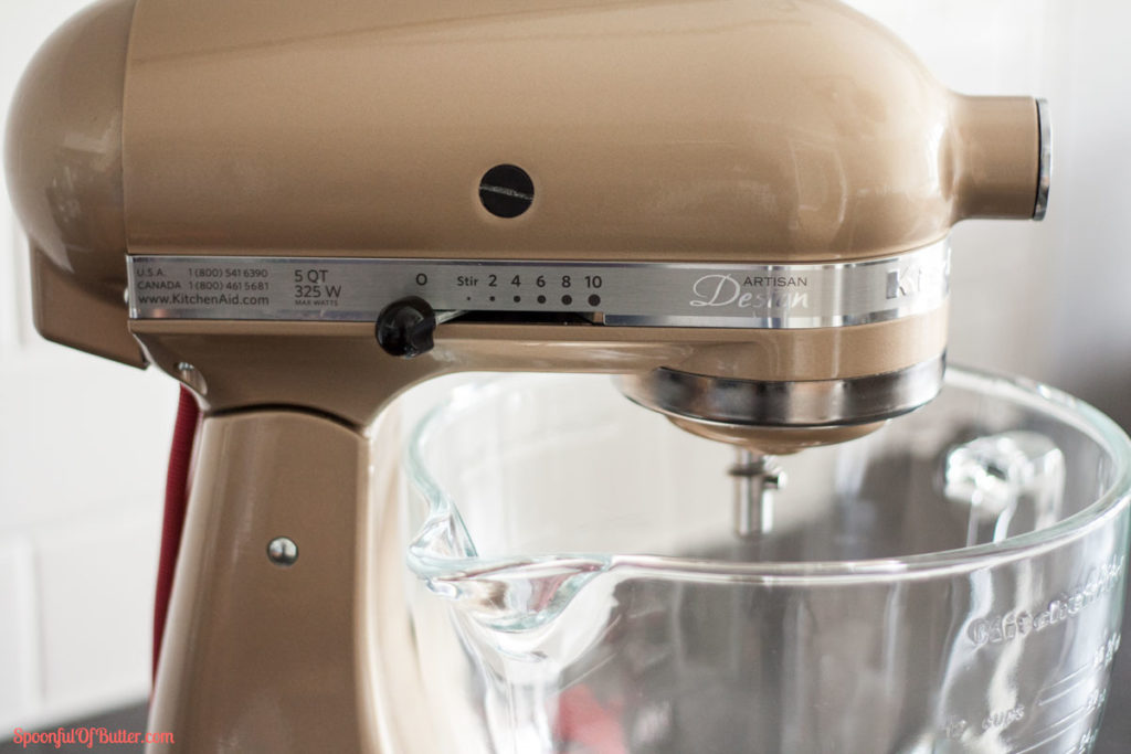A stand mixer focusing on the speed lever