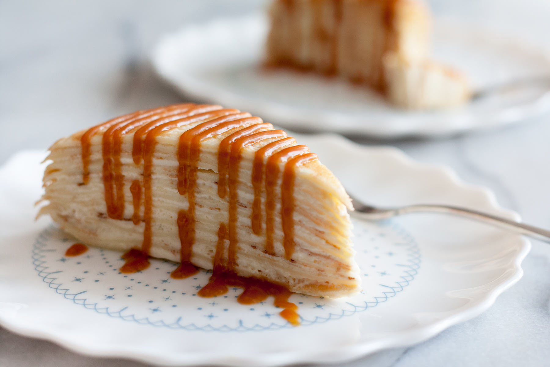 Decadent, classic French cake consisting of 12 layers of paper thin crepes separated with pastry cream, plus variations on how you can serve it in different ways just by adding 1 or 2 ingredients!