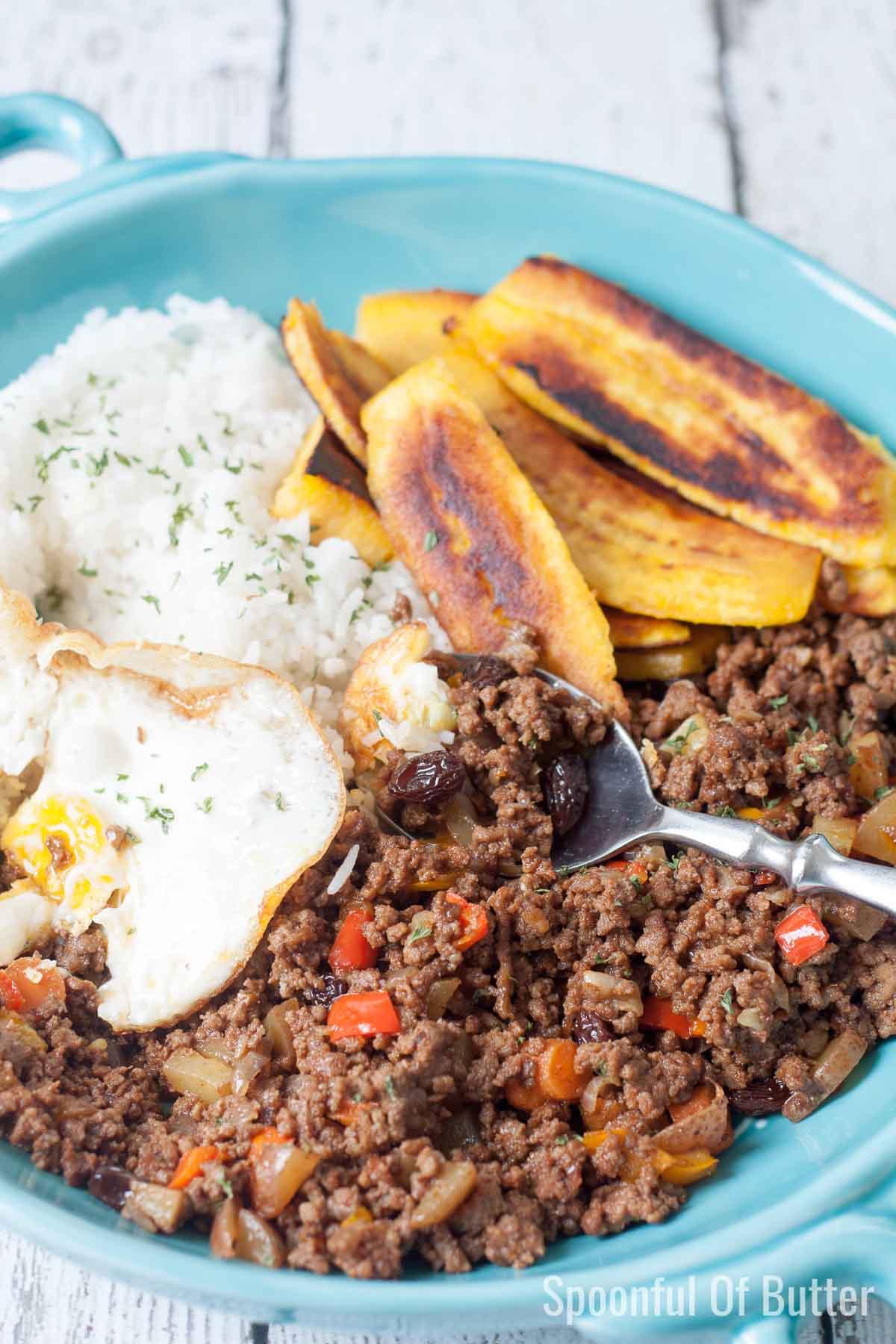 Arroz a la Cubana on a plate with a spoon