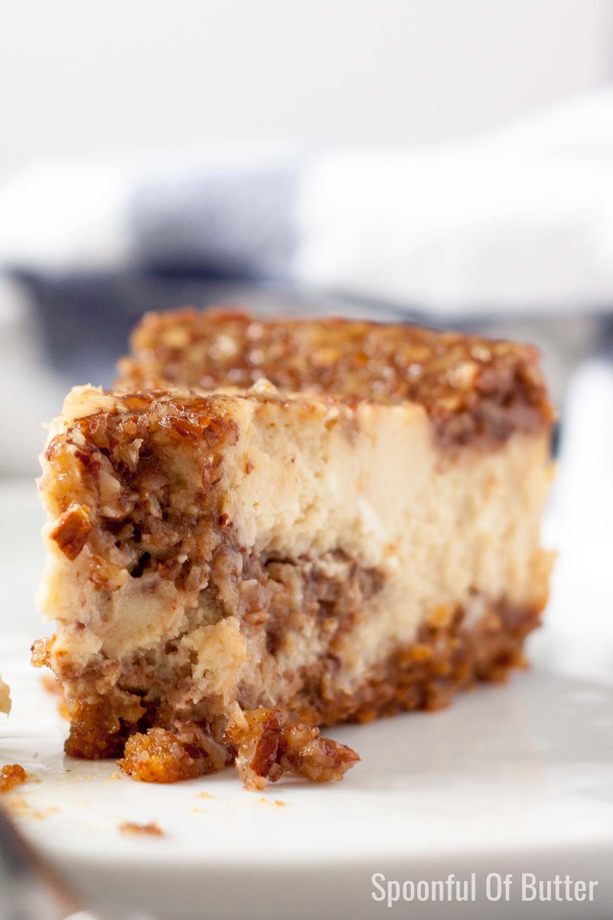 Close-up shot of sliced Pecan Pie Cheesecake